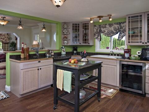 kitchen, island, green, cabinets, hardwood floors