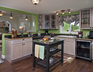 kitchen, island, green, cabinets, hardwood floors